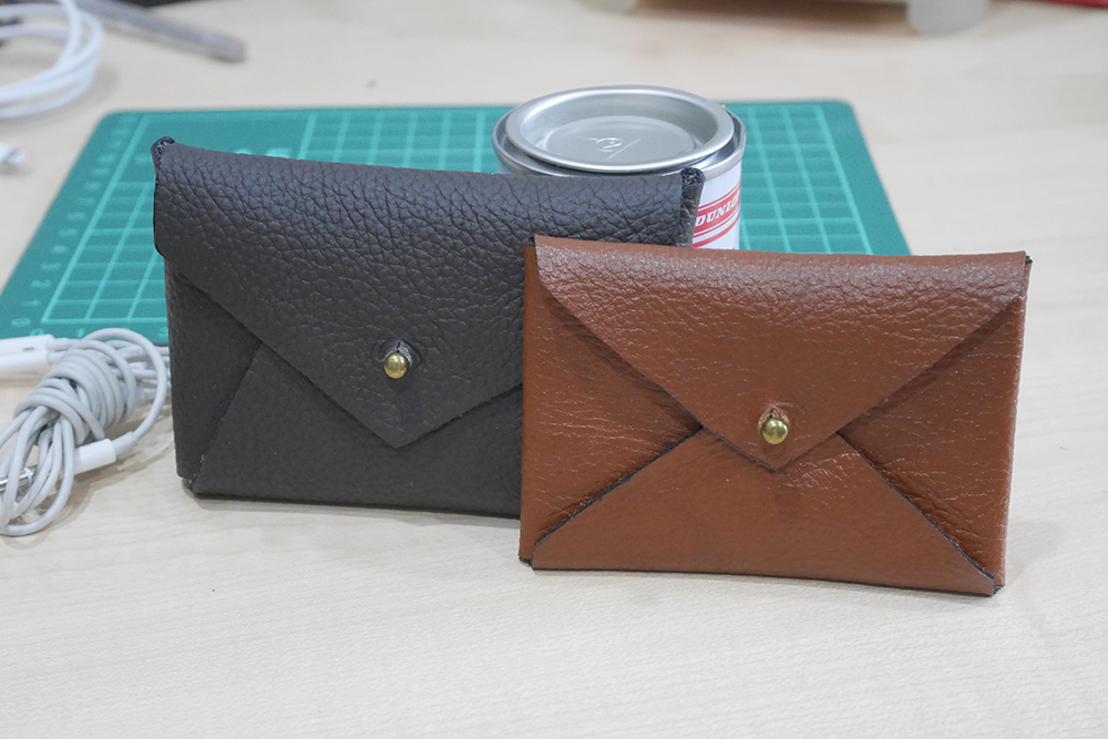 Different sized leather envelop pouches